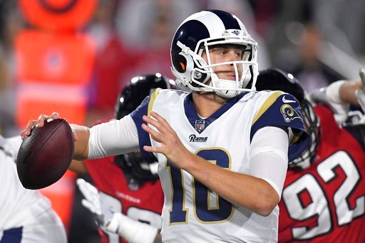 (AP Photo/Mark J. Terrill). Los Angeles Rams quarterback Jared Goff looks to pass during the first half of an NFL football wild-card playoff game against the Atlanta Falcons, Saturday, Jan. 6, 2018, in Los Angeles.