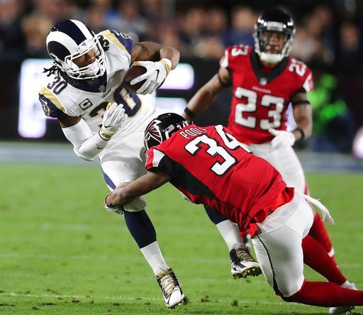 (Curtis Compton/Atlanta Journal-Constitution via AP). Atlanta Falcons cornerback Brian Poole tackles Los Angeles Rams running back Todd Gurley during the first half of an NFL football wild-card playoff game Saturday, Jan. 6, 2018, in Los Angeles.