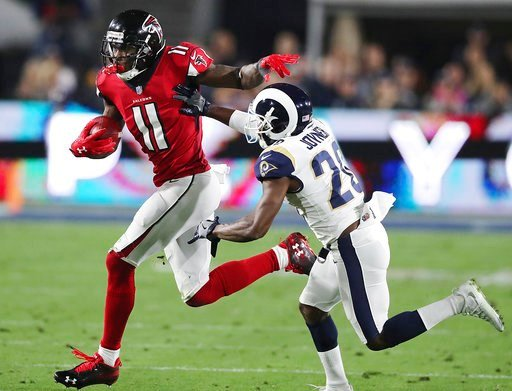 (Curtis Compton/Atlanta Journal-Constitution via AP). Atlanta Falcons' Julio Jones picks up a first down past Los Angeles Rams' Lamarcus Joyner on a run during the first half of an NFL football wild-card playoff game Saturday, Jan. 6, 2018, in Los Ange...