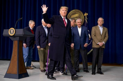 (AP Photo/Andrew Harnik). President Donald Trump, accompanied by Republican congressmen and members of his cabinet, departs after speaking at a news conference following a Congressional Republican Leadership Retreat at Camp David, Md., Saturday, Jan. 6...