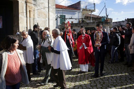 """(AP Photo/Armando Franca). Gabriel Setas, center, wearing his crown, takes part in a procession after being chosen as the new """"king"""" during the local Kings' Feast in the village of Vale de Salgueiro, northern Portugal, Saturday, Jan. 6, 2018. At right,..."""