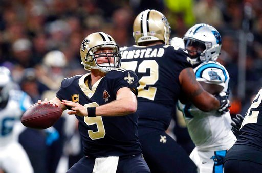 (AP Photo/Butch Dill). New Orleans Saints quarterback Drew Brees (9) passes in the first half of an NFL football game against the Carolina Panthers in New Orleans, Sunday, Jan. 7, 2018.