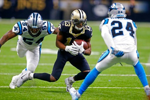 (AP Photo/Butch Dill). New Orleans Saints wide receiver Michael Thomas (13) carries on a pass reception between Carolina Panthers outside linebacker Shaq Green-Thompson (54) and cornerback James Bradberry (24) in the first half of an NFL football game ...
