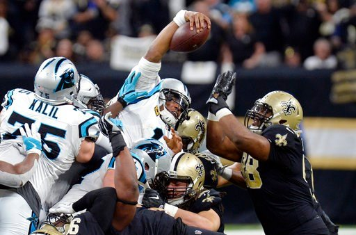 (AP Photo/Bill Feig). Carolina Panthers quarterback Cam Newton (1) reaches over the pile for a first down in the first half of an NFL football game against the New Orleans Saints in New Orleans, Sunday, Jan. 7, 2018.