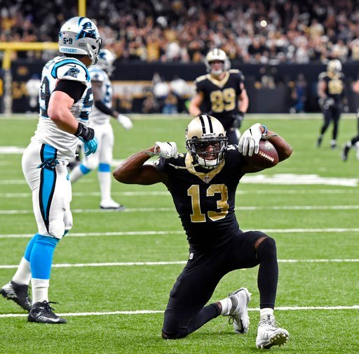 (AP Photo/Bill Feig). New Orleans Saints wide receiver Michael Thomas (13) reacts after a long first down reception in the second half of an NFL football game against the Carolina Panthers in New Orleans, Sunday, Jan. 7, 2018.