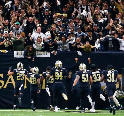 (AP Photo/Butch Dill). New Orleans Saints players rush the fans after sacking Carolina Panthers quarterback Cam Newton to turn the ball over on downs, in the second half of an NFL football game in New Orleans, Sunday, Jan. 7, 2018. The Saints won 36-21.