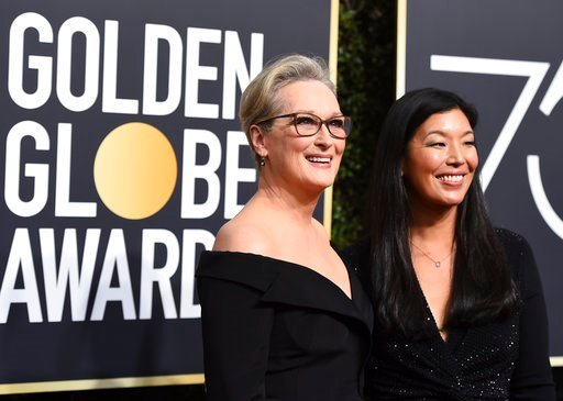 (Photo by Jordan Strauss/Invision/AP). Meryl Streep, left, and Ai-jen Poo arrive at the 75th annual Golden Globe Awards at the Beverly Hilton Hotel on Sunday, Jan. 7, 2018, in Beverly Hills, Calif.