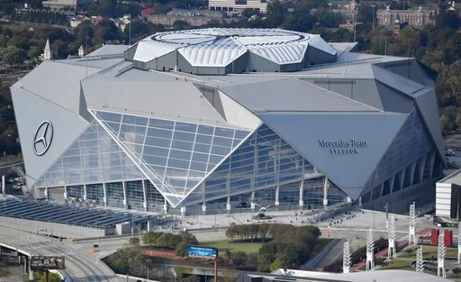 (AP Photo/Mike Stewart, File). FILE - This Nov. 1, 2017, file photo shows the Mercedes-Benz stadium in Atlanta. Atlanta's new $1.5 billion stadium is about to be on perhaps its largest national stage for the Monday, Jan. 8, 2018, College Football Playo...