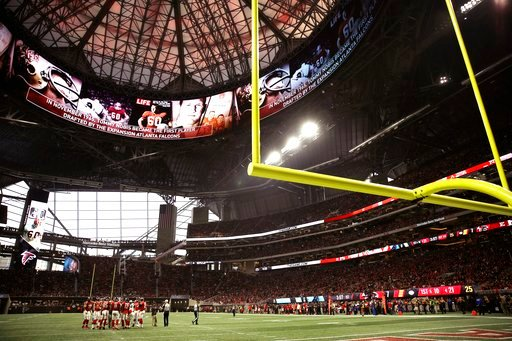 (AP Photo/David Goldman, File). FILE - In this Dec. 31, 2017, file photo, the Atlanta Falcons and Carolina Panthers huddle during the first half of an NFL football game, in Atlanta. Atlanta's new $1.5 billion stadium is about to be on perhaps its large...