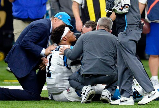 (AP Photo/Bill Feig). Carolina Panthers quarterback Cam Newton (1) is tended to by medical personnel after being sacked in the second half of an NFL football game against the New Orleans Saints in New Orleans, Sunday, Jan. 7, 2018.