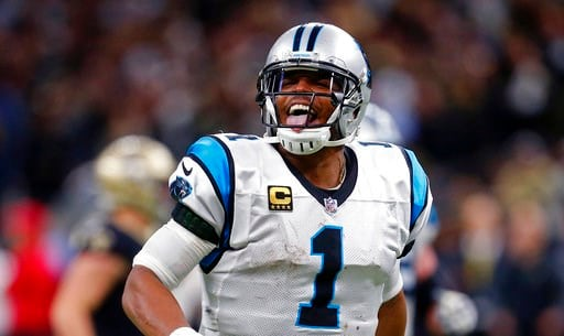 (AP Photo/Butch Dill). Carolina Panthers quarterback Cam Newton (1) reacts after throwing a touchdown pass in the second half of an NFL football game against the New Orleans Saints in New Orleans, Sunday, Jan. 7, 2018.