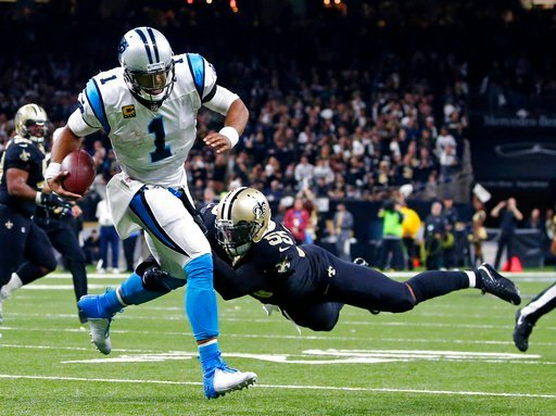 (AP Photo/Butch Dill). New Orleans Saints linebacker Jonathan Freeny (55) sacks Carolina Panthers quarterback Cam Newton (1) on a third down, forcing the Panthers to kick a field goal, in the second half of an NFL football game in New Orleans, Sunday, ...