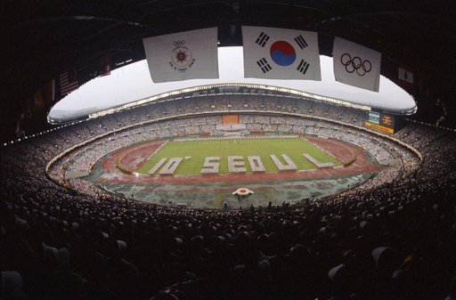 (Yonhap via AP, File). In this Sept. 20, 1986, file photo, an opening ceremony for the Asian Games is held at Olympic stadium in Seoul, South Korea. North Korea boycotted the games.