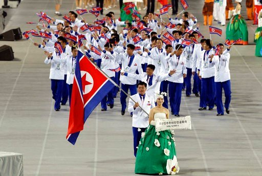 (AP Photo/Dita Alangkara, File). In this Sept. 19, 2014, file photo. athletes from North Korea march into the stadium during the opening ceremony for the 17th Asian Games in Incheon, South Korea. North Korea attended the Asian Games.