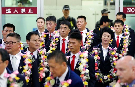 (AP Photo/Lee Jin-man, File). In this June 23, 2017, file photo, North Korean taekwondo demonstration team members and other officials arrive at Gimpo International Airport in Seoul, South Korea.