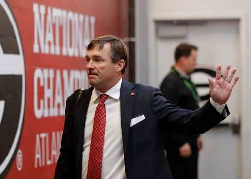 (AP Photo/John Bazemore). Georgia head coach Kirby Smart waves as the team arrives before the NCAA college football playoff championship game against Alabama Monday, Jan. 8, 2018, in Atlanta.