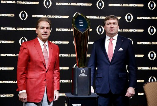 (AP Photo/David Goldman). Alabama head coach Nick Saban, left, and Georgia head coach Kirby Smart pose with the NCAA college football championship trophy at a press conference in Atlanta, Sunday, Jan. 7, 2018. Georgia and Alabama will be playing for th...
