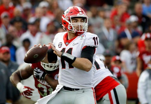 (AP Photo/Jae C. Hong, File). FILE- In this Monday, Jan. 1, 2018, file photo, Georgia quarterback Jake Fromm throws a pass during the Rose Bowl NCAA college football game against Oklahoma in Pasadena, Calif. Georgia plays Alabama in the Monday, Jan. 8,...