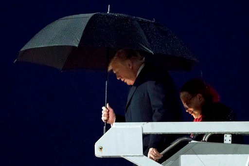 (AP Photo/Andrew Harnik). President Donald Trump accompanied by Dr. Alveda King, niece of civil rights activist Dr. Martin Luther King Jr., right, arrives at Dobbins Air Reserve Base in Marietta, Ga., Monday, Jan. 8, 2018, to attend the NCAA National C...