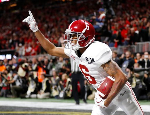 (AP Photo/David Goldman). Alabama wide receiver DeVonta Smith (6) celebrates his touchdown during overtime of the NCAA college football playoff championship game against Georgia, Monday, Jan. 8, 2018, in Atlanta. Alabama won 26-23 in overtime.