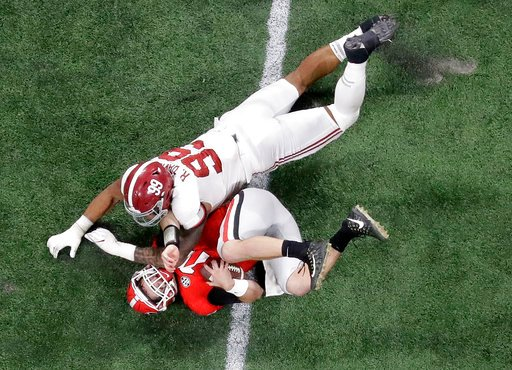 (AP Photo/John Bazemore). Alabama's Raekwon Davis sacks Georgia's Jake Fromm during the second half of the NCAA college football playoff championship game Monday, Jan. 8, 2018, in Atlanta.