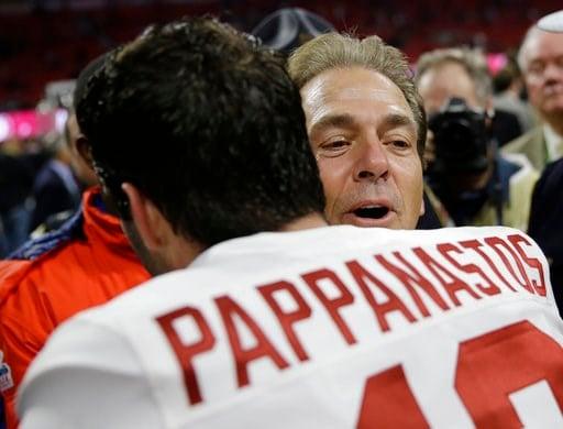 (AP Photo/David Goldman). Alabama head coach Nick Saban hugs Andy Pappanastos after overtime of the NCAA college football playoff championship game against Georgia, Monday, Jan. 8, 2018, in Atlanta. Alabama won 26-23.