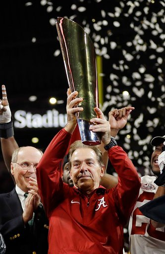 (AP Photo/David J. Phillip). Alabama head coach Nick Saban holds up the championship trophy after overtime of the NCAA college football playoff championship game against Georgia, Monday, Jan. 8, 2018, in Atlanta. Alabama won 26-23.
