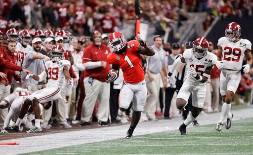 (AP Photo/David J. Phillip). Georgia running back Sony Michel runs doer a first down during the first half of the NCAA college football playoff championship game against Alabama Monday, Jan. 8, 2018, in Atlanta.