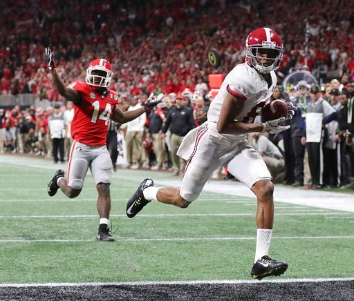 (Curtis Compton/Atlanta Journal-Constitution via AP). Alabama wide receiver Devonta Smith runs into the end zone for a touchdown after catching a pass past Georgia defensive back Malkom Parrish during overtime of the NCAA college football playoff champ...