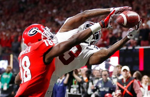 (AP Photo/David Goldman). Georgia's Deandre Baker knocks the ball away from Alabama's Calvin Ridley during the second half of the NCAA college football playoff championship game Monday, Jan. 8, 2018, in Atlanta.