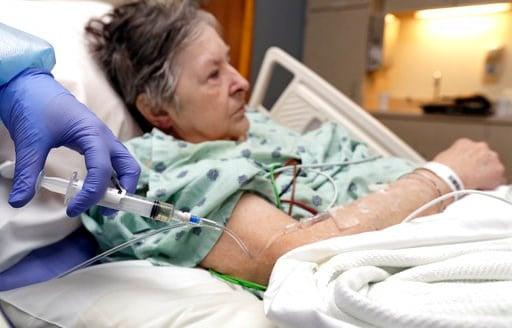(AP Photo/Tony Dejak). In this Monday, Jan. 8, 2018, photo, a nurse administers an I.V. push of antibiotics to Alice McDonald at ProMedica Toledo Hospital in Toledo, Ohio. A nasty flu season is hitting U.S. hospitals already scrambling to maintain pati...