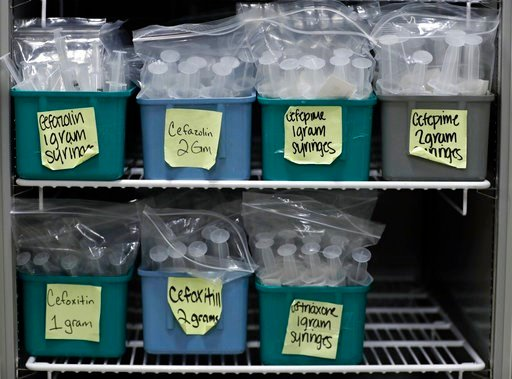 (AP Photo/Tony Dejak). In this Monday, Jan. 8, 2018, photo, a refrigerator is filled with finished batches of stored syringes for I.V. pushes at ProMedica Toledo Hospital, in Toledo, Ohio. A nasty flu season is hitting U.S. hospitals already scrambling...
