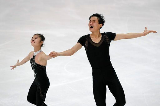 (AP Photo/Matthias Schrader, File). FILE - In this Friday, Sept. 29, 2017, file photo, Ryom Tae Ok and Kim Ju Sik of North Korea compete during the pairs free program at the Figure Skating-ISU Challenger Series in Oberstdorf, Germany. South Korea said ...
