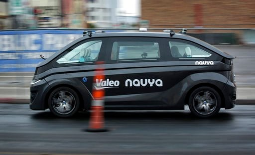 (AP Photo/John Locher). A Navya Autonom Cab, a self-driving vehicle, drives down a street during a demonstration at CES International, Monday, Jan. 8, 2018, in Las Vegas.