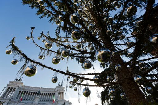 """(AP Photo/Alessandra Tarantino). This photo taken on Dec. 19, 2017 shows, Rome's official Christmas tree standing in front of the Unknown Soldier monument in downtown Rome. Rome's city cabinet decided on the tree's """"new life"""" Tuesday, Jan. 9, 2018, hop..."""