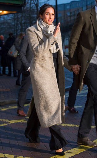 (AP Photo/ Dominic Lipinski, Pool). Meghan Markle waves to the crowd as she leaves after a visit with Britain's Prince Harry to the Reprezent 107.3 FM radio station in Brixton, south London, Tuesday, Jan. 9, 2018. The royal couple visited Tuesday to se...
