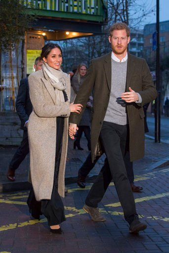 (AP Photo/ Dominic Lipinski, Pool). Britain's Prince Harry, right, and his fiancee Meghan Markle leave after a visit to the Reprezent 107.3 FM radio station in Brixton, south London, Tuesday, Jan. 9, 2018. The royal couple visited Tuesday to see the st...