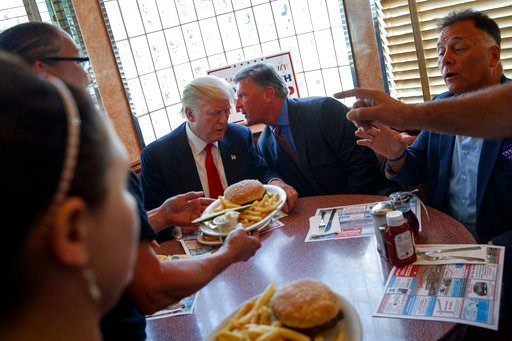 (AP Photo/Evan Vucci, File). FILE - In this Sept. 12, 2016, file photo, then-Republican presidential candidate Donald Trump sits down for lunch during a visit to the Boulevard Diner in Dundalk, Md. President Donald Trump is getting his first medical ch...