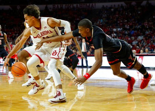 (AP Photo/Garett Fisbeck). Oklahoma's Trae Young (11) drives the ball away from Texas Tech's Jarrett Culver, right, during the first half of an NCAA college basketball game in Norman, Okla., Tuesday, Jan. 9, 2018.