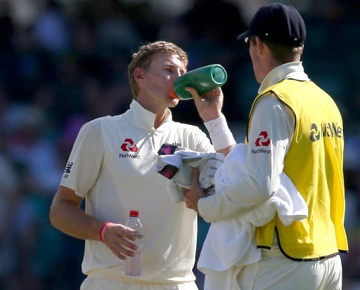 (AP Photo/Rick Rycroft, File). FILE - In this Jan 7, 2018, file photo, England's Joe Root drinks during a break in play against Australia during the fourth day of their Ashes cricket test match in Sydney. Roots was hospitalized with severe dehydration ...
