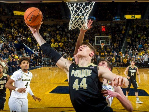 (AP Photo/Tony Ding). Purdue center Isaac Haas (44) goes to the basket as Michigan forward Isaiah Livers (4) watches during the second half of an NCAA college basketball game at Crisler Center in Ann Arbor, Mich., Tuesday, Jan. 9, 2018. Purdue won 70-69.