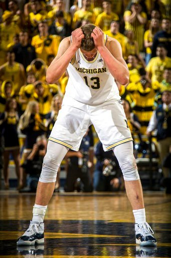(AP Photo/Tony Ding). Michigan forward Moritz Wagner reacts after the team's NCAA college basketball game against Purdue at Crisler Center in Ann Arbor, Mich., Tuesday, Jan. 9, 2018. Wagner was called for a foul in the final seconds to allow Purdue a f...