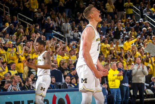 (AP Photo/Tony Ding). Michigan forward Moritz Wagner, foreground, react to a 3-point basket by guard Charles Matthews, left, during the first half of the team's NCAA college basketball game against Purdue at Crisler Center in Ann Arbor, Mich., Tuesday,...