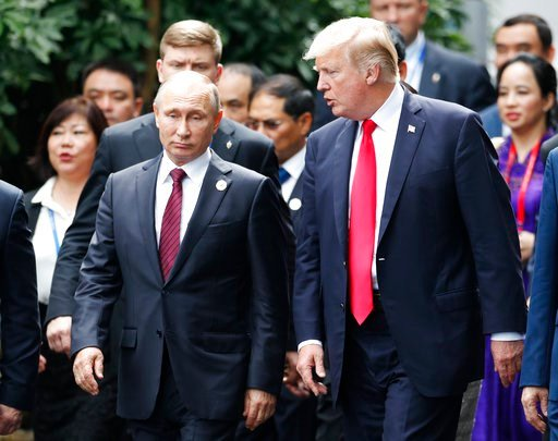(Jorge Silva/Pool Photo via AP, File). In this Nov. 11, 2017, file photo President Donald Trump, right, and Russia's President Vladimir Putin talk during the family photo session at the APEC Summit in Danang, Vietnam.