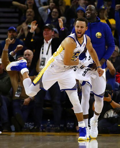 (AP Photo/Ben Margot). Golden State Warriors' Stephen Curry (30) and Draymond Green celebrate a score against the Denver Nuggets during the second half of an NBA basketball game Monday, Jan. 8, 2018, in Oakland, Calif.