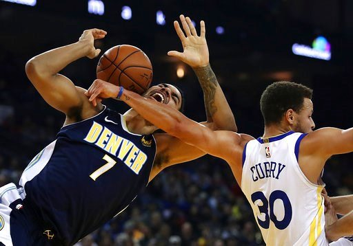 (AP Photo/Ben Margot). Denver Nuggets' Trey Lyles, left, is fouled by Golden State Warriors' Stephen Curry (30) during the first half of an NBA basketball game Monday, Jan. 8, 2018, in Oakland, Calif.