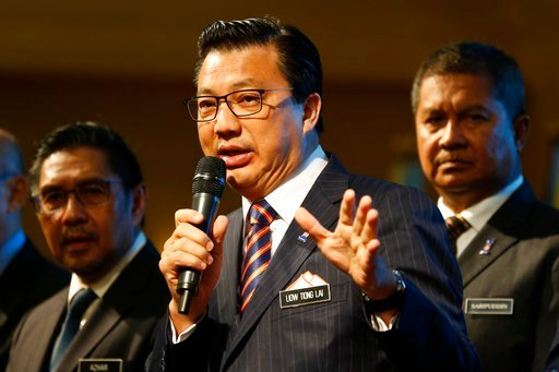 (AP Photo/Sadiq Asyraf). Malaysian Minister of Transport, Liow Tiong Lai, center, speaks during the signing ceremony of the MH370 missing plane search operations between Malaysian government and Ocean Infinity Limited in Putrajaya, Malaysia.