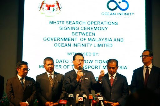 (AP Photo/Sadiq Asyraf). Malaysian Minister of Transport Liow Tiong Lai, center, speaks at a press conference during MH370 missing plane search operations signing ceremony between the government of Malaysia and the Ocean Infinity Limited.