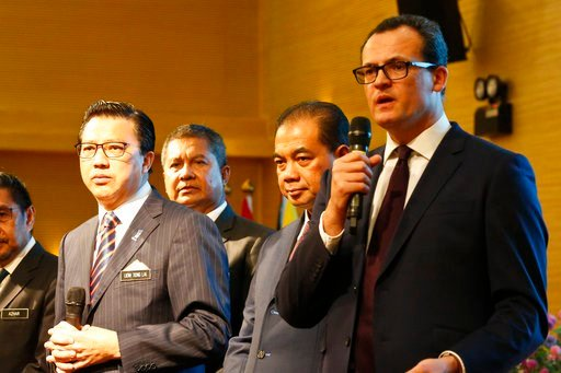 (AP Photo/Sadiq Asyraf). CEO of Ocean Infinity Limited, Oliver Plunkett, right, speaks at a press conference during the MH370 missing plane search operations signing ceremony between the governement of Malaysia and the Ocean Infinity Limited.