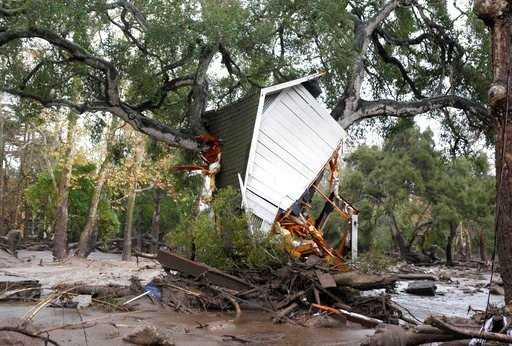 (Daniel Dreifuss). A structure is smashed against a tree along Hot Springs Road in Montecito, Calif. after getting hit by a flash flood and debris flow on Tuesday, Jan. 9, 2018. Several homes were swept away before dawn Tuesday when mud and debris roar...